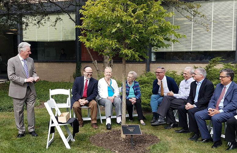 Memorial tree planting in honor of the late Charles R. Bauer